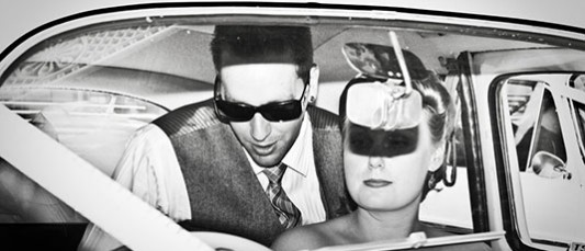 Scene from the 50s Celebrity Couple in a car blinded by a firing camera flash Ballarat Wedding Photography Lydiard Street