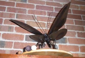 Metal moth with drumsticks